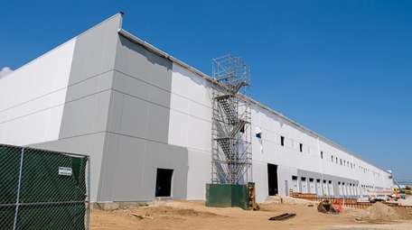 A Home Depot warehouse is under construction on