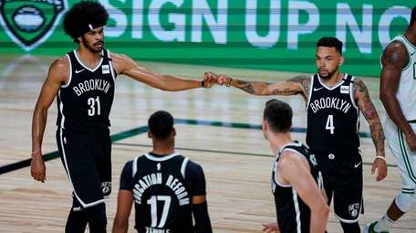 Brooklyn Nets center Jarrett Allen (31) and guard