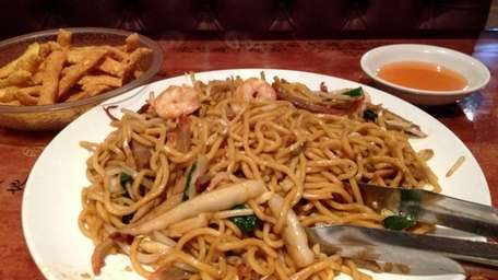 Shrimp and pork lo mein is served at