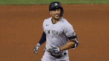 Giancarlo Stanton #27 of the Yankees celebrates a