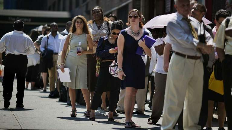 File photo of job seekers waiting in line