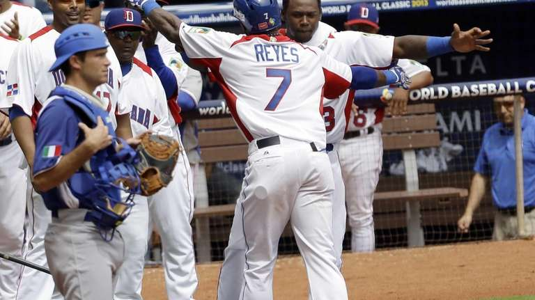 Dominican Republic's Jose Reyes is congratulated by teammate