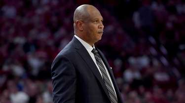 Kentucky associate head coach Kenny Payne watches from
