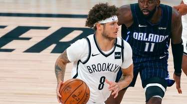 Nets guard Tyler Johnson (8) drives past the
