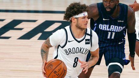 Nets guard Tyler Johnson (8) drives past the