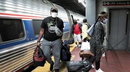 Amtrak travelers arriving on a train that originated