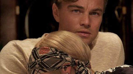 Leonardo DiCaprio as Jay Gatsby and Carey Mulligan