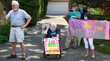Rosalia Zona, who turned 108, watches a birthday