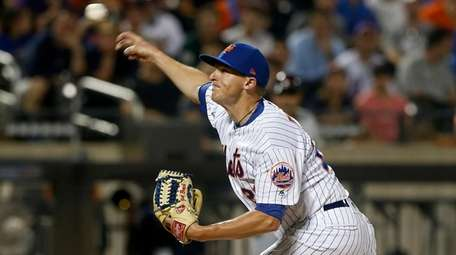 Brad Brach of the Mets pitches during the