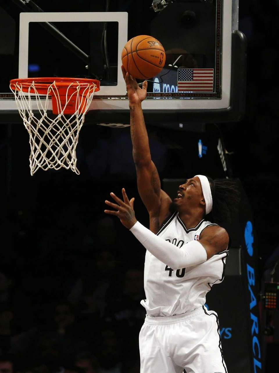 Gerald Wallace of the Nets goes to the