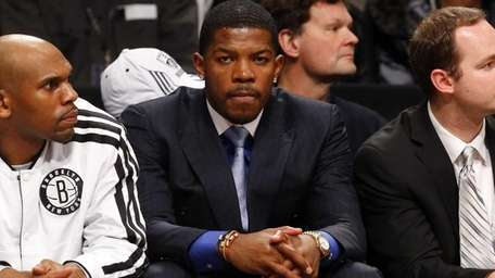 Joe Johnson of the Nets looks on from