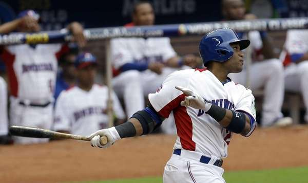 Dominican Republic's Robinson Cano follows through on his