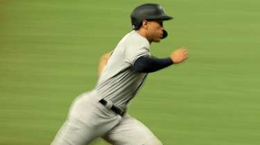 Giancarlo Stanton of the Yankees scores a run