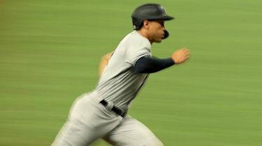 Giancarlo Stanton of the Yankees scores a run