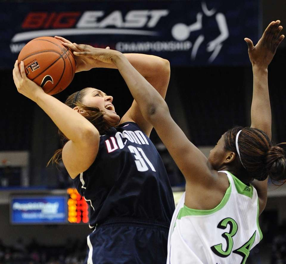 Connecticut's Stefanie Dolson drives to the basket while