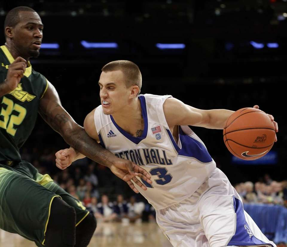Seton Hall's Haralds Karlis drives past South Florida's