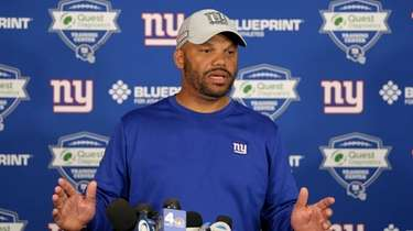 Giants special teams coordinator Thomas McGaughey speaks to