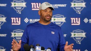 Giants special teams coordinator Thomas McGaughey speaks to