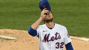Mets starting pitcher Steven Matz walks to the