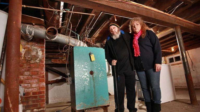Loretta and Eddie Heredia in the basement of