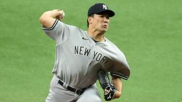Masahiro Tanaka of the Yankees throws against the