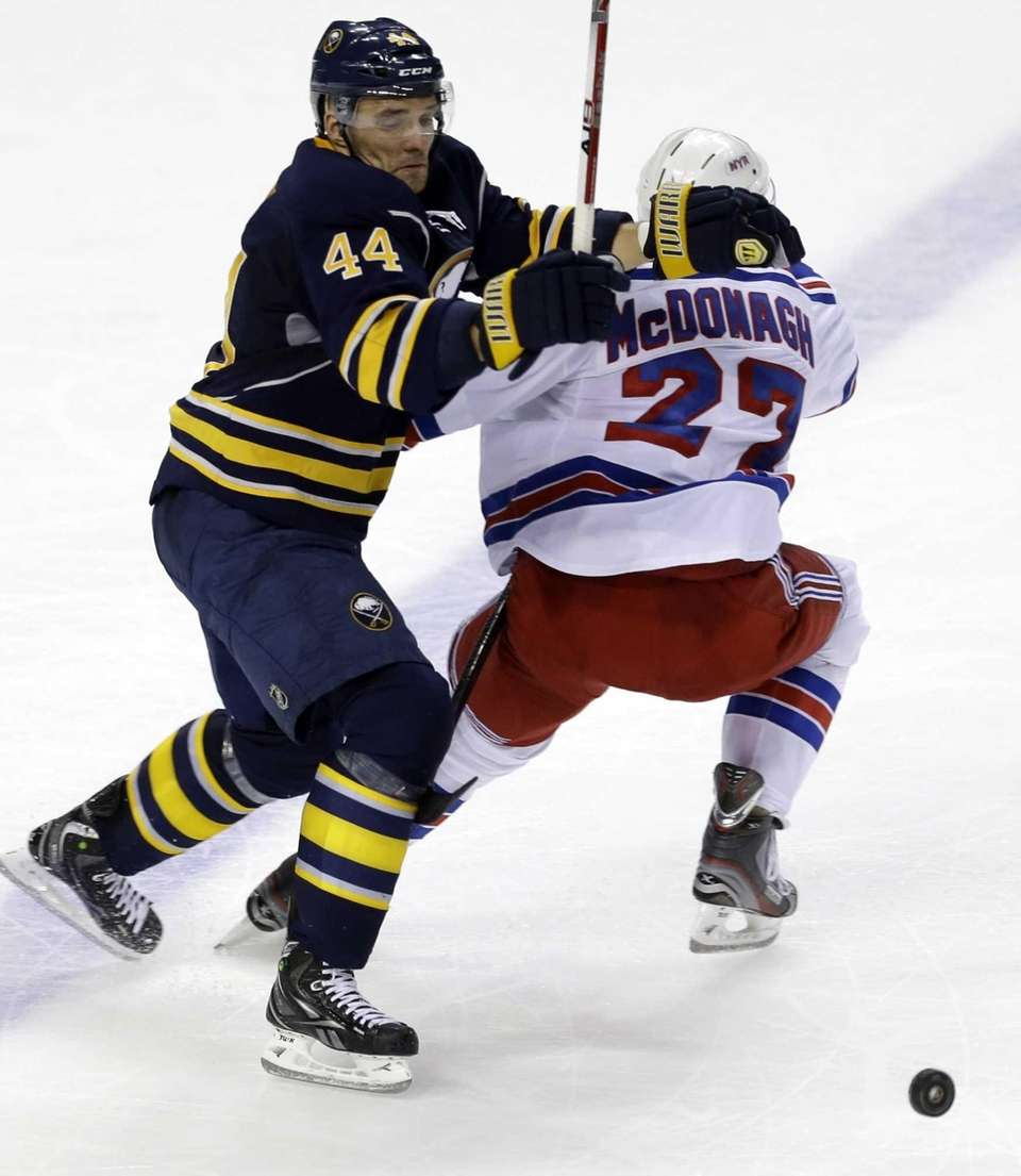 Buffalo Sabres' Andrej Sekera battles for the puck