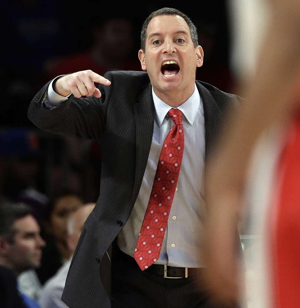 Rutgers head coach Mike Rice calls out to