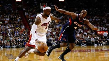 LeBron James of the Miami Heat drives against