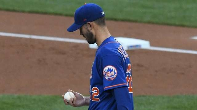 Mets starting pitcher Rick Porcello reacts after Nationals