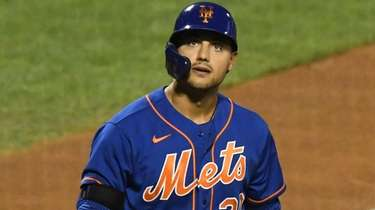 Mets rightfielder Michael Conforto returns to the dugout