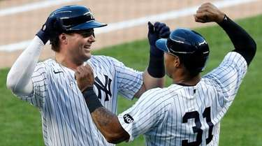 Luke Voit of the Yankees celebrates his first-inning