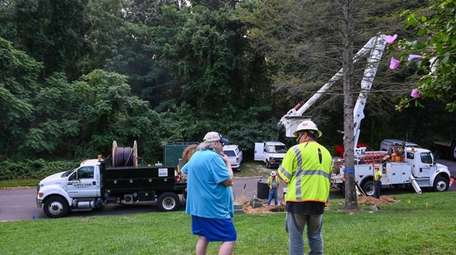 An electrical worker speaks to Rich Gladd, a