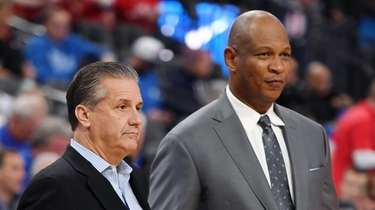 John Calipari (L) and Kenny Payne watch Kentucky