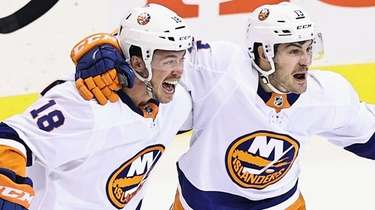 Anthony Beauvillier of the Islanders, left, celebrates his