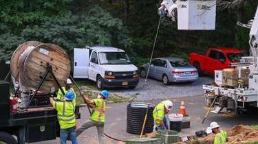 Hawkeye Electric crews work on restoring power to