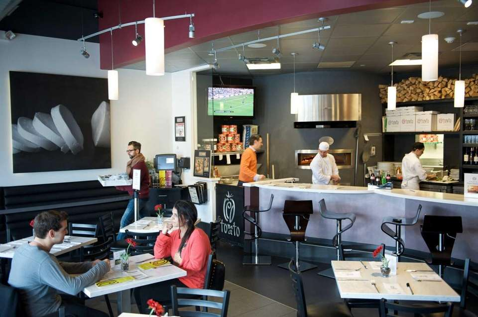Red Tomato has an open kitchen and counter