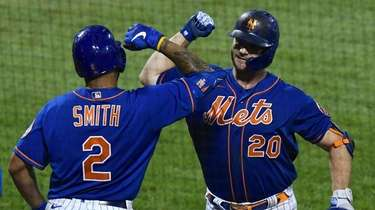 The Mets' Pete Alonso, facing, celebrates his two-run