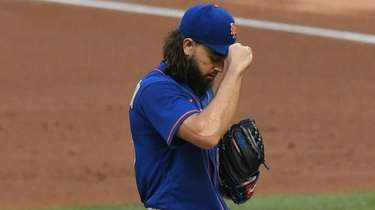 Mets starting pitcher Robert Gsellman stands on the