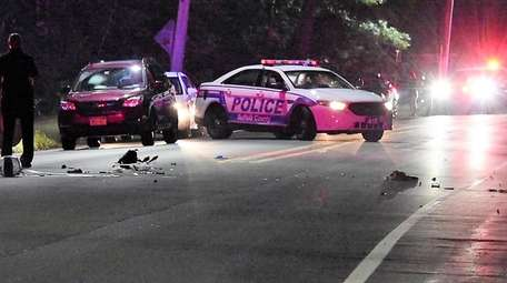 Suffolk County police at a fatal motorcycle crash