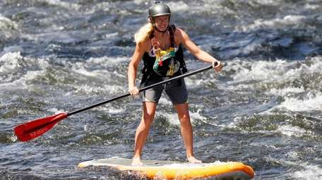 Jaime Iadicicco of upstate Queensbury paddleboards down the