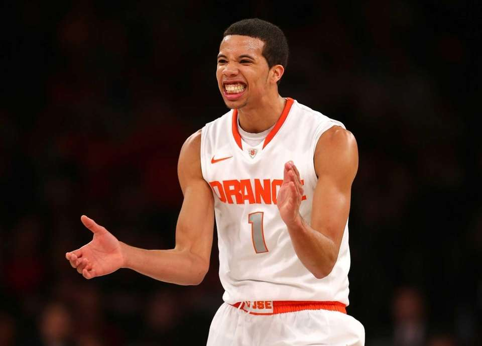 Syracuse's Michael Carter-Williams reacts after a play in