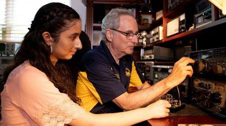 Howard Bernstein teaches morse code to his daughter