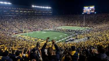 Fans cheer as the Michigan team takes the