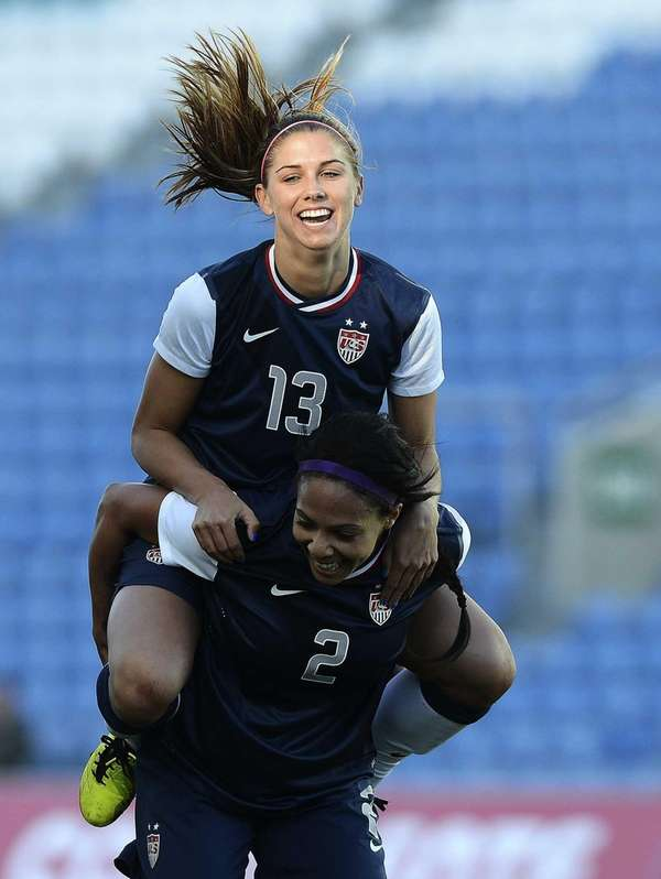 U.S. forward Alex Morgan, top, celebrates after scoring