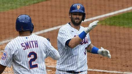Mets catcher Tomas Nido celebrates his two-run home