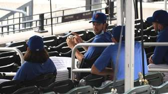 New York Mets pitcher Steven Matz sits with