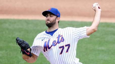 David Peterson of the Mets pitches against the