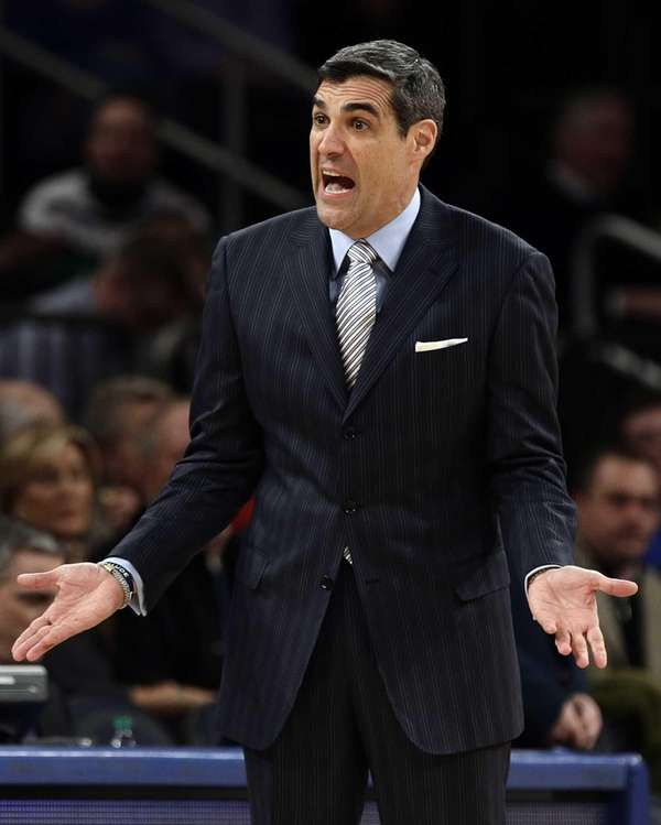 Villanova head coach Jay Wright calls out to