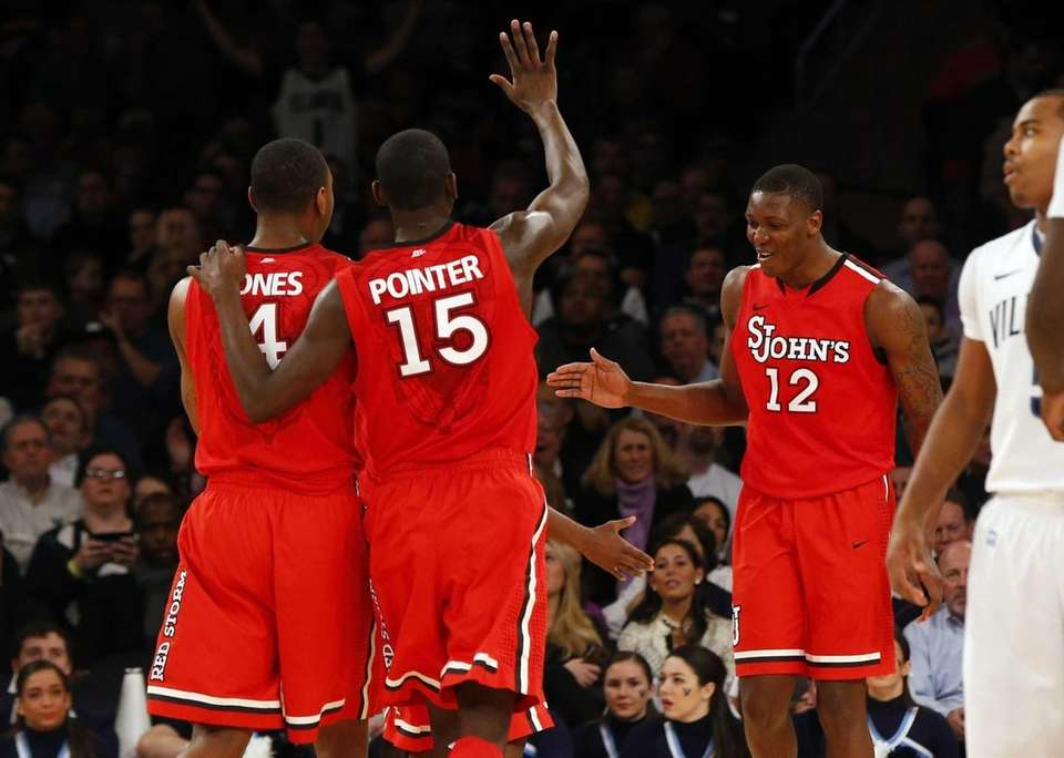 Chris Obekpa celebrates a turnover with teammates Christian
