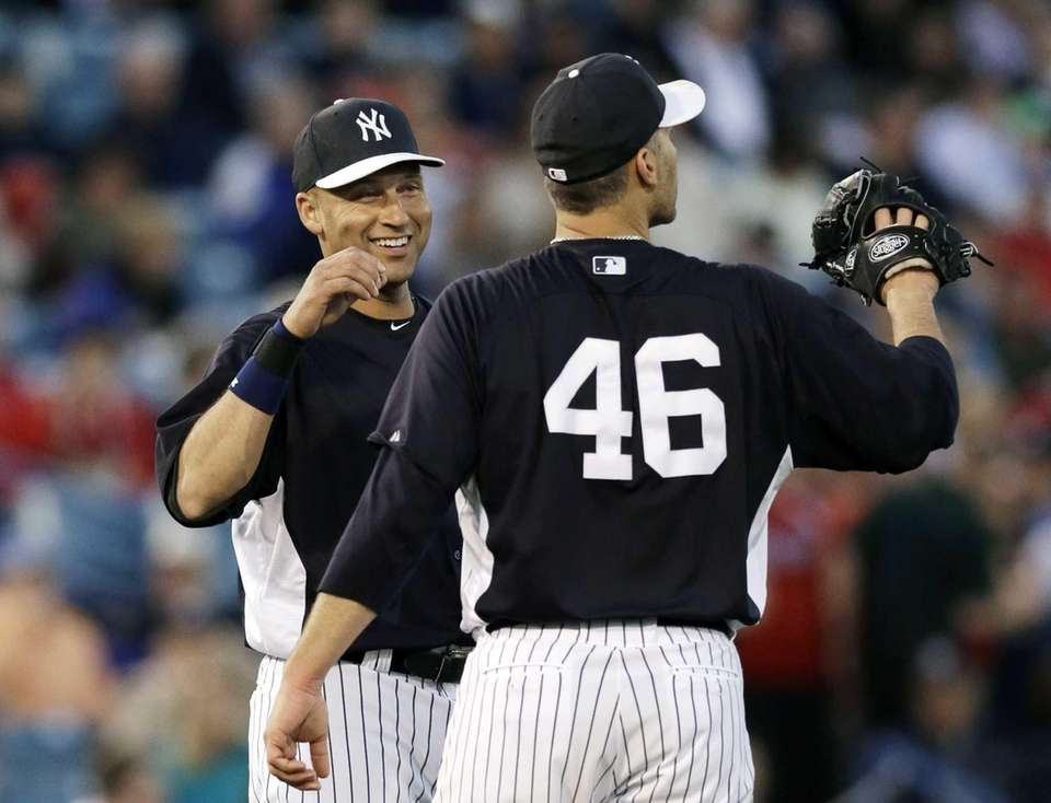 Derek Jeter talks to Andy Pettitte during a
